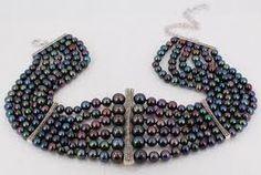 Mmmmm strands and strands of black pearls...  -from kaziadigo.com