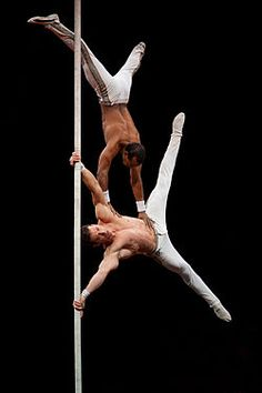 Two Cuban acrobats on the Chinese pole, performing at Grenoble. Chinese poles are vertical poles on which circus performers climb, slide down and hold poses. The poles are generally between 3 and 9 metres (10 and 30 ft) in height and approximately 5 to 8 cm (2 to 3 inches) in diameter. Photo: Ludovic Péron