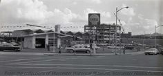 Shell Gasoline Station at the corner of Madison and Southbridge Streets, November 14, 1963, Worcester Massachusetts. Photograph by George Cocaine.  Want a cop of this photo?  >Visit our rights and reproductions page for more information.    #Worcester #WorcesterMA #WorcesterHistory #GeorgeCocaine #1960s #Construction #Automobiles #StreetScenes