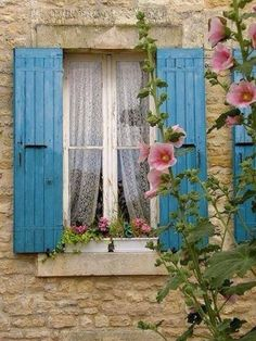 French Windows with hollyhock Blue Shutters, Window Shutters, Window Boxes, Exterior Shutters, Old Windows, Windows And Doors, French Windows, Poitou Charentes France, Cottage Windows