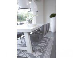 Het tapijtpatroon kun je ook gewoon verven op een houten of betonnen vloer