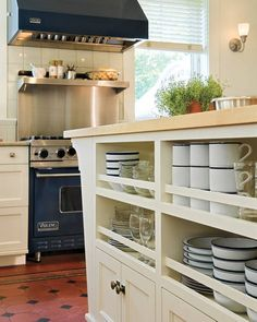 Kitchen Decorating Ideas: A Kitchen Built for Comfort - ELLE DECOR - I love the under the counter open storage