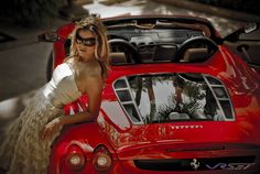 female-model-leaning-red-ferrari-f430-convertible-rear