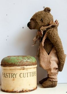 Wow an old vintage bear and a old rusty piece of Enamelware. I know what board this is going on.