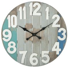 """Wood material Requires 1 AA Battery Slatted Wood Wall Clock. CBK Home and Outdoor Living Dimensions: 28 7/8"""" L. x 1 3/4"""" W. x 28 7/8"""" H."""
