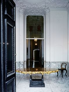 Inside the Century headquarters of haute couture house Viktor & Rolf: The entrance hall hosts a Studio Job 'Robber Baron' table and, in each corner, a 'Rock' chair. Architecture Details, Interior Architecture, Interior And Exterior, Entry Hallway, Entrance Hall, Amsterdam Houses, Loft Interiors, Vogue Living, Viktor Rolf