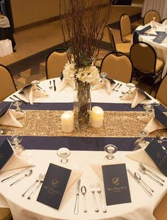 navy blue and gold wedding table decor / http://www.deerpearlflowers.com/navy-blue-and-gold-wedding-color-ideas/