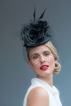 Handcrafted in our London studio.Straw cocktail hat with swarovski crystal encrusted veil, Silk flower and arrowhead quills.Colour: Black Secured with a comb and hairband.1 in stock, delivery 3-5 business days. Sent free within the UK. Includes a Black