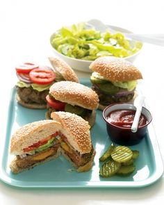 Cheddar-Stuffed Burgers Tuck a slab of cheddar cheese into each patty of ground chuck to make these delicious stuffed burgers. Putting the cheese inside the burger leaves room for more toppings, so pile on all the tomatoes, pickles, onion, and sauteed mushrooms you like.