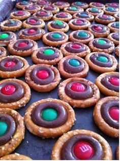 CHRISTMAS PRETZELS                   Great, simple idea!!       Ingredients: Small Pretzels Hershey's Kisses (unwrapped) m&ms Directions: Top each pretzel with a Hershey's Kiss, and place in a preheated 200ºF oven for 10 minutes. Remove and immediately press an m&m into the top of each kiss. Let cool completely! (If you don't eat them all immediately, that is!) The kids will love to help[ with these. FOLLOW FOR MORE IDEAS