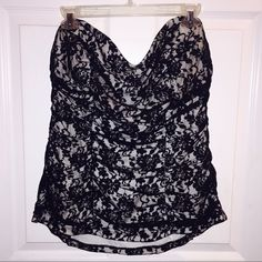 Torrid- Strapless Black Lace Top Torrid store brand- Black lace tube strapless top. Elastic in back. Gripping in front to keep from slipping down. Ruching detail. Slip on style. Lace overlay on cream base. Women's Plus size 1 (equivalent to a 14). Excellent condition, worn one time. Torrid Tops Camisoles