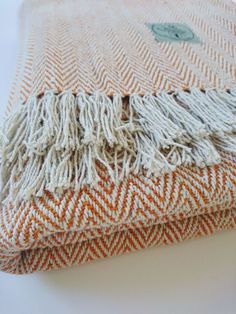Yoga blanket - ORANGE : 100 % cotton, handwoven and handmade in Nepal. It comes in 4 color variations. Made in the Himalayas with love, for the environmental conscious yogis and nature lovers. A multifunctional tool in your asana or meditation practice. Roll, fold and use as support, cover yourself up in shavasana or meditation to keep warm with only natural fibers.