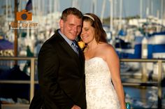 Bride and Groom by Harbor. Beach wedding pictures.