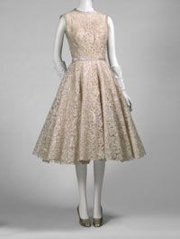 Philadelphia Museum of Art - Woman's Dress and Belt Made in New York, United States, North and Central America  1954  Designed by Norman Norell, American, 1900 - 1972. Made by Traina-Norell, New York, 1941 - 1960. Sold by the Tribout Shop, John Wanamaker, Philadelphia. Worn by Mrs. Jacob Sklaroff.  Sized machine-made cotton lace with machine-appliquéd iridescent acetate strips, iridescent acetate sequins, silk taffeta