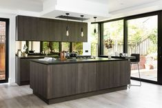 Modern handleless kitchen with an island | Family kitchen in London, UK  |    Kitchen by Elan Kitchens, 55 New King's Road, London, SW6 4SE. Tel: 020 7384 0511 Email: info@elankitchens.co.uk Website: www.elankitchens.co.uk Hampstead London, Handleless Kitchen, Modern Kitchens, Family Kitchen, Kitchen Island, Website, Home Decor, Houses, Island Kitchen
