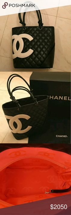 Chanel cambon tote Beautiful black and white chanel carbon bag. Its well taken care of. Its pretty much new. Leather is still stiff not broken in yet. Hot pink interior. Looks orange but its hot pink. Taking offers. Chanel Bags Totes