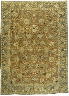 An early 20th century Persian Tabriz antique rug, the cinnamon field with an allover lattice of palmettes, feathery leaves and flowering vinery within a moss green border with stylized palmettes. Watch full size video of A Persian Tabriz rug, Circa 1900, ID BB3367 - Video