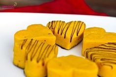 Indian sweets - Mango barfi recipe   Ingredients:  2 ripe kesar mangoes 100g sweetened condensed milk 100ml double cream 1/4 tsp vanilla seeds (or extract if you don't have seeds) brown sugar to taste (if required) 250g milk powder 3 cardamom pods some good quality dark chocolate, optional.