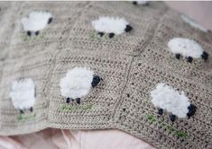 Crochet Baby Blankets Beautiful wool baby blanket with fluffy little sheep. Blanket is made in squares with intarsia fluffy sheep. Squares are crocheted together.Pattern originally featured in Inside Crochet magazine.Written in UK crochet terminology Wool Baby Blanket, Crochet Baby Blanket Beginner, Crochet Blanket Patterns, Knitting Patterns, Crochet Blankets, Baby Blankets, Crochet Afghans, Sewing Patterns, Crochet Sheep