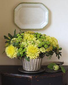 A bright arrangement of mums, zinnias, spearmint and celosia. (marthastewart.com)