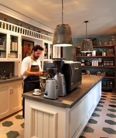 Idea for brew tasting/coffee/espresso bar space  (just an image of the counter with bean grinders/espresso machine.  tin covered counter and light fixtures)