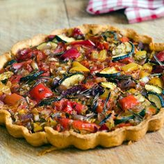 Delicious roasted parsnips%2C red onions and peppers%2C seasoned with a tasty chargrilled flavour mix%2C on a base of crispy shortcrust pastry and topped with Parmesan cheese.