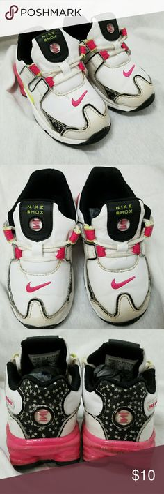 NIKE Shox Girls Size 7C Athletic Shoes Brand: Nike  Item: *White Nike Shox in Size 7 C *The Back Sole is Dark Pink *Each Shoe Has a Dark Pink Swoosh on Top of the Foot & a Neon Yellow One on the Outside *The Heel is Navy Blue wirh White Stars *The Pink Part of the Soles Do Show Some Wear & Rubbing *Good Pre-Loved Condition  *no trades, offers via offer button only* Nike Shoes Sneakers
