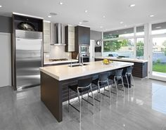Overwhelming Charcoal Home Off The Park : Stunning luminous kitchen in grey and metallic scheme with a lot of recessed lighting