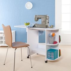 This white sewing table is a perfect way to keep all your thread, needles, and other sewing items together and in arms reach. The table folds together and can be rolled away for easy storage when not in use. The two roomy shelves boast a lot of space.