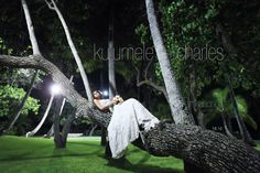 """We're so lucky ~ we have coolest clients.  Mele climbs a tree at 10pm after her wedding for the """"hero shot"""""""