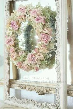 Pretty cream and pink wreath with roses, attached to a white shabby chic frame