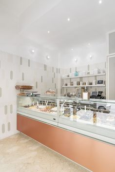 Caledoiscopio Architettura - the walls of the ice cream parlor are covered with tiles from the Dart collection by Tonalite