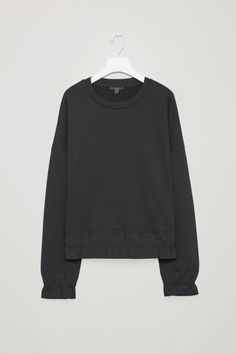 COS image 5 of Sweatshirt with woven frills in Black
