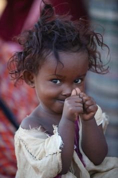Beautiful shy smile from Somalia... What a doll baby. All children deserve to smile.