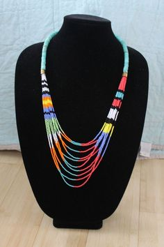 Colorful Multi Strand Beaded Necklace by annamerkeljewelry on Etsy Bunte Multi Strang Perlenkette von annamerkeljewelry auf Etsy This image has. Bead Jewellery, Seed Bead Jewelry, Tribal Jewelry, Beaded Jewelry, Handmade Jewelry, Jewelry Necklaces, Bracelets, Seed Bead Necklace, Simple Necklace