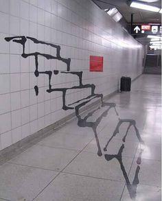 Arte callejero. Escaleras que salen de la pared.
