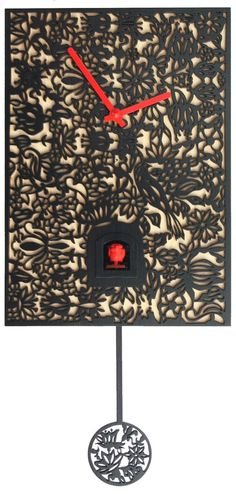 """Model #SNQ2 Modern Design Quartz Cuckoo Clock, Musical, Black & Natural Filigree     11"""" H x 8"""" W x 5"""" D,  Quartz cuckoo,  Laser-cut design,  Plays 12 Melodies,  Made in Germany,  Shut-off switch.     This is a beautiful modern crafted cuckoo clock designed by the award-winning Conny Haas."""