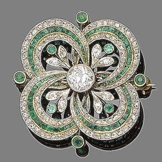 An emerald and diamond brooch/pendant, circa 1915