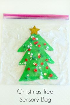 This Christmas tree sensory bag is so much fun and it's really quite simple to make too. It's also an excellent way to develop fine motor skills!