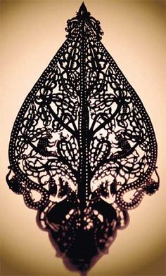 Filigree ... a 20th-century Malaysian tree of life design is used in shadow puppetry.