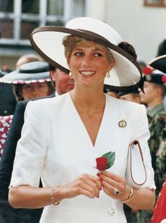 Princess Diana, wearing a Catherine Walker dress and Marina Killery hat, attends the Gulf War Victory Parade at Portsmouth June 1991.