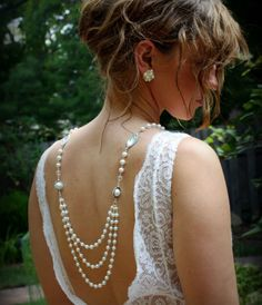 Try something unique: wear a necklace backwards. This is especially cool if your prom dress is backless.