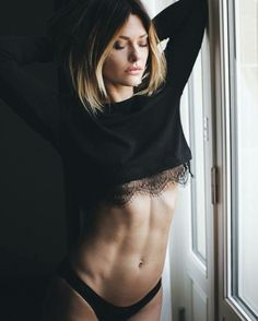 Bombshell Caroline Receveur shows off her toned abs.