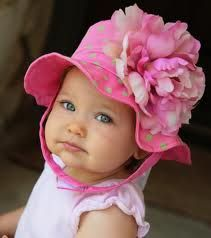 cutey saying Mommy why are you making me wear this hat...can the photo shoot be over :)