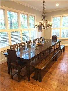 """13' L x 42"""" W Farmhouse Table with a traditional top and tapered legs in Dark Walnut stain with a semi-gloss finish. Pictured with a matching Farmhouse Bench, William Dining Chairs, and antique end chairs."""