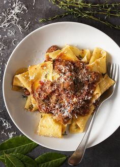 Braised Pork Shoulder Ragu Italian comfort food of tomato, braised sausage, and pork shoulder ragu simmering on the stove is the perfect way to spend a chilly day. This pork ragu is easily doubled and freezes well. Pork Recipes, Pasta Recipes, Cooking Recipes, Rice Recipes, Crockpot Recipes, Chicken Recipes, Braised Pork Shoulder, Pork Ragu, Meat Lovers