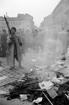 In front of the offices of the Secret Police, members of the Hungarian insurrection destroy Soviet propaganda and portraits of Stalin. Budapest, Photo by Erich Lessing. Budapest, Rare Historical Photos, World History, History Pics, Old Pictures, Amazing Pictures, The Past, Around The Worlds, In This Moment