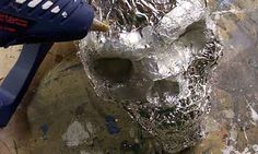 Cheap Skulls - Static prop. Cover skull with foil, then cover with hot glue and then paint. Tutorial attached.