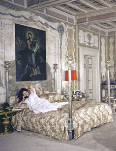 Sophia Loren poses for photographer Alfred Eisenstaedt, in 1964, in the master bedroom of Villa Sara, her 16th-century house near Rome. Purchased in 1952 by her future husband, producer Carlo Ponti, it was restored with architect and garden designer Imerio Maffeis and decorated by costume-and-set designer Ezio Altieri. The bedroom features frescoes of the four seasons, which were moved there from another room in the house; the Louis XVI painted bed was made in Tuscany.