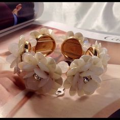 Beautiful Floral Bracelet This beautiful stretch bracelet features beige flowers with rhinestone embellished buds. Gold tone setting. Measures 9 inches around. (This closet does not trade or use PayPal ) Jewelry Bracelets